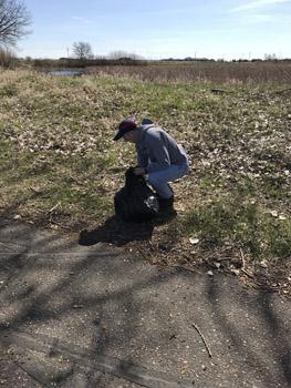 Dan picking up garbage