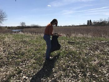 Sarah picking up garbage